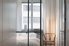 modern ceiling to floor metal frame glass doors act as space dividers but don't make the bedroom look small thanks to the glass