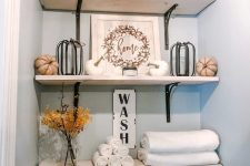 open shelving looks stylish in a small bathroom
