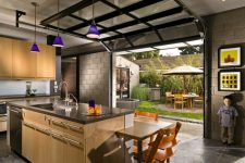 open your kitchen to the courtyard with a garage door to enjoy your meals outside or enjoy fresh air while doing things in the kitchen