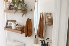 rust-colored towels, billy balls in a vase will easily and effortlessly give your bathroom a cool fall look and you won't need to do a lot with them