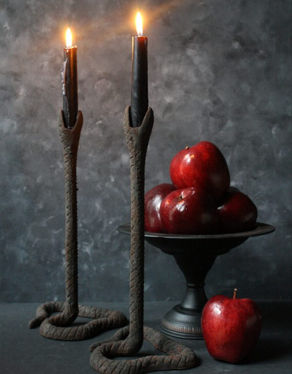 scary textural snake candleholders with black candles are perfect for styling your home for this holiday