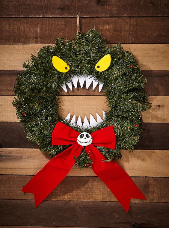 such a Halloween monster wreath of faux evergreens, eyes, teeth and a large bow can be used not only at Halloween but also at Christmas