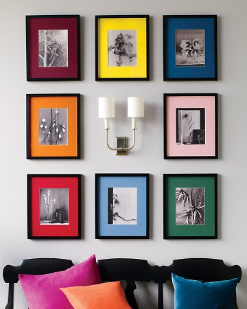 Colorful family photo display (via marthastewart)