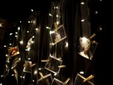 String lights family photo display (via pinterest)