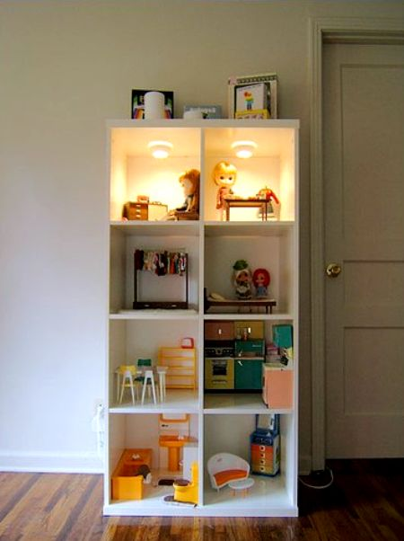 DIY Dollhouse Made Of A Simple Bookcase From IKEA (via shelterness)