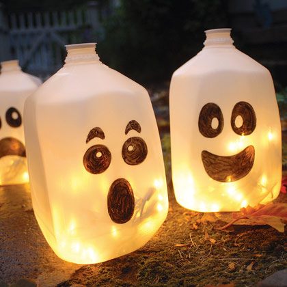 You can draw faces on plastic gallon milk jugs with permanent marker and put string lights in each of them. You'll get yourself really gorgeous luminaries. DIY Glowing Milk Jug Ghosts
