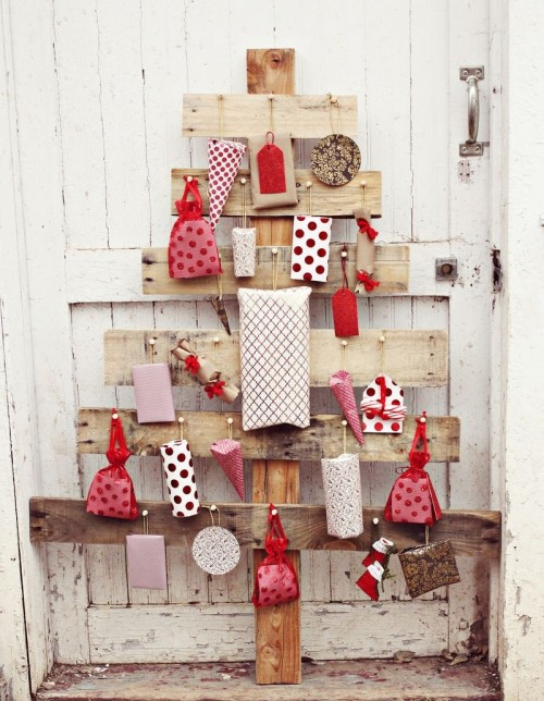 wooden planks wall advent tree (via abeautifulmess)