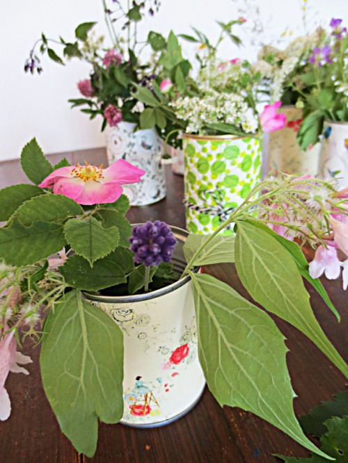 colorful paper tin can vases (via photowall)