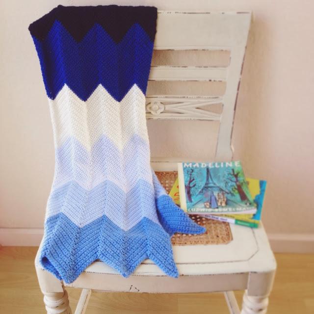 crocheted blue blanket
