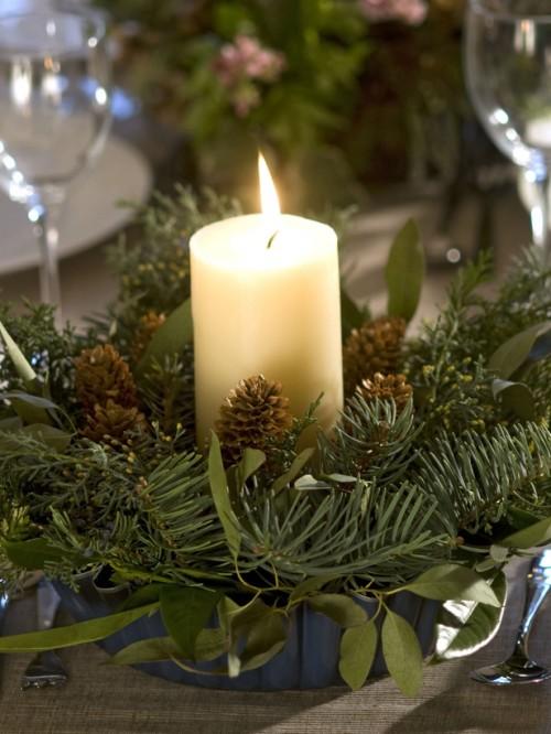 evergreen and candle centerpiece (via hgtv)