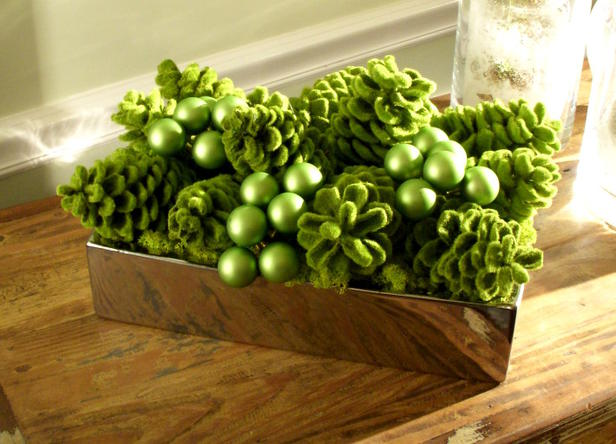 green moss and faux pinecones centerpiece