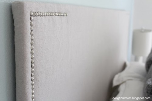 upholstered headboard with a nail pattern (via delightfulmom)