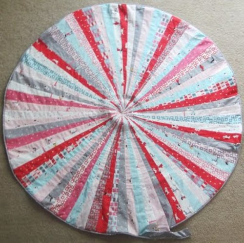 Amazing DIY Jelly Roll Floor Pillows - Shelterness
