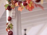 an apple and leaf Thanksgiving garland in bright colors is a very natural fall decor idea you cna easily realize yourself