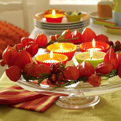 Candle lights is the best addition to any festive dinner. Wrap them in a DIY candle holders made from cupcake forms.