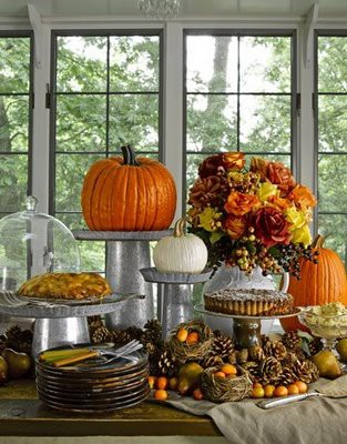 Nix the candles and use the candles' pedestals for pumpkins! That would give dimension to your table design.