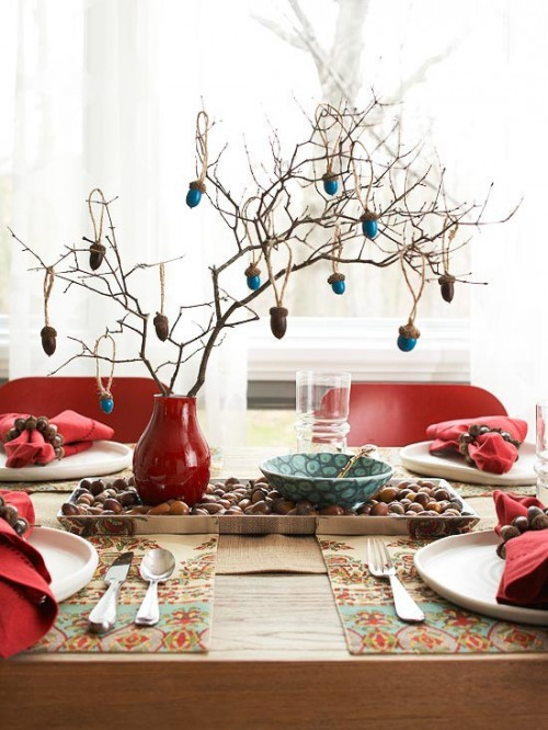 Take an interesting piece of a tree from your backyard, put it in a vase and add some hanging ancorns on it.  Such DIY centerpiece would look awesome on any festive fall dinner.
