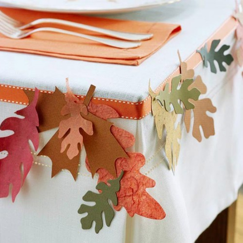 Print a bunch of leaf stencils and cut felt leaves using them. These leaves would make a perfect garland or you can simply glue to the table cloth.