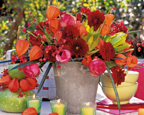 Here is a super simple yet very effective fall centerpiece idea. Take a concrete bucket and stuff it with colorful fall blooms. Such centerpiece would be a vibrant color splash on any table.