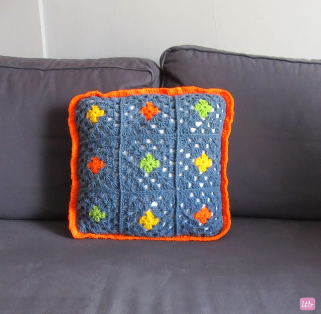 crocheted square pillow