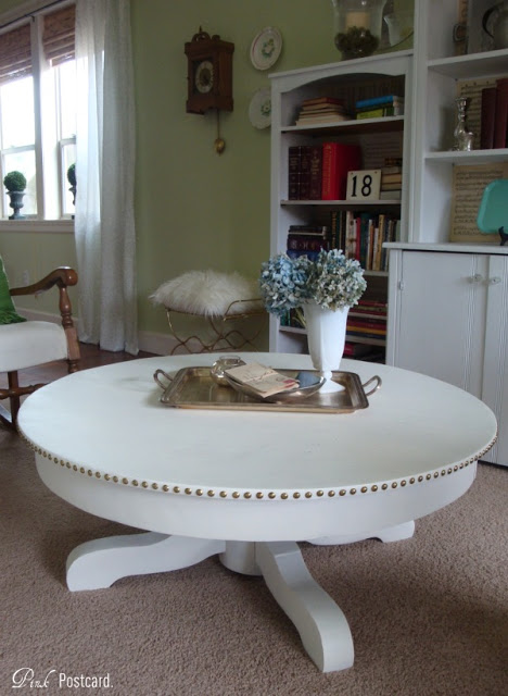Cool white round coffee table with nails via pink postcard