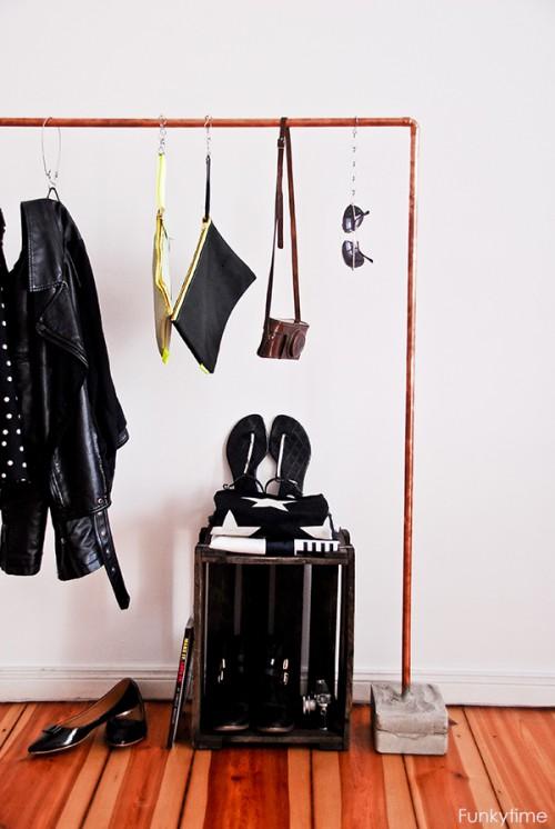 copper and concrete clothes rack (via shelterness)