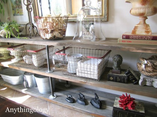 diy industrial shelves of plumber pipes (via anythingologyblog)