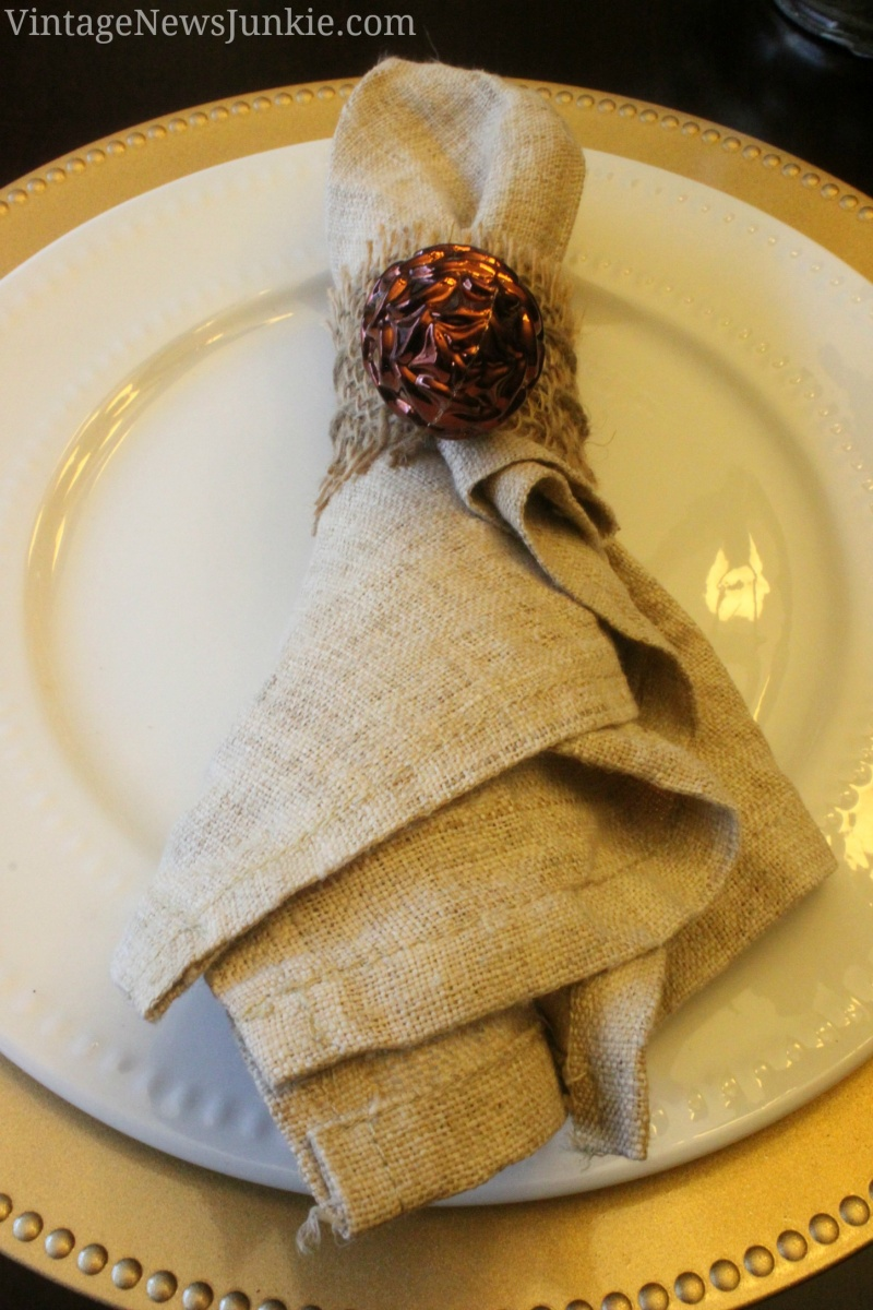 burlap and gilded pinecone napkin rings