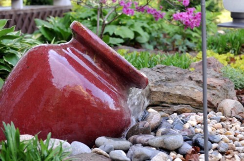 An alternative way to make a homemade garden fountain of a ceramic pot. You can't move it but it looks cool!