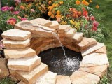 pond with a waterfall fountain