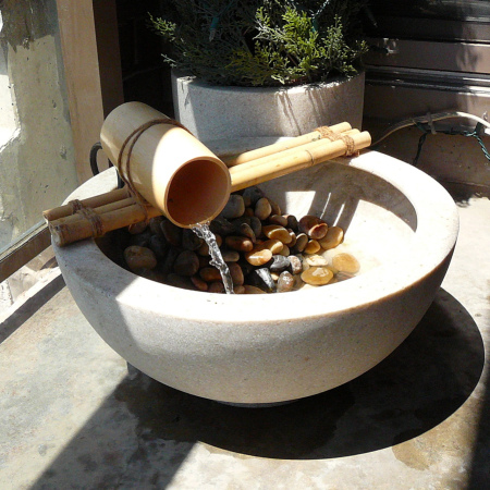 "Small bamboo water feature. It's made of 3/4"" diamater bamboo pieces, garden twine and a bamboo cup. Btw, a tiki torch would be a nice addition to such cuteness. (via safaffect)"