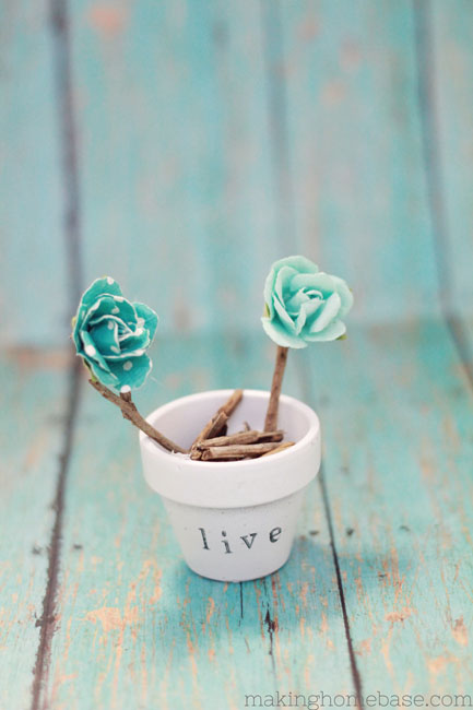spring decor stamped pots (via shelterness)