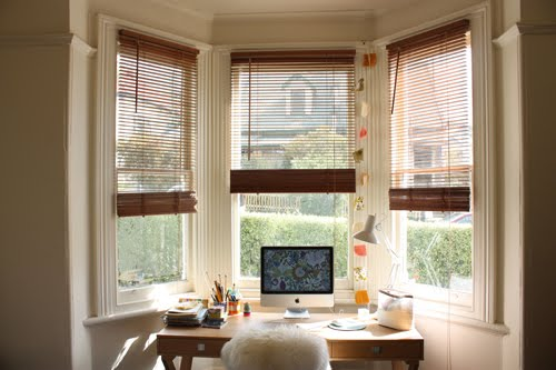 Built-in and traditional desks are a beautiful way to use a bay window.