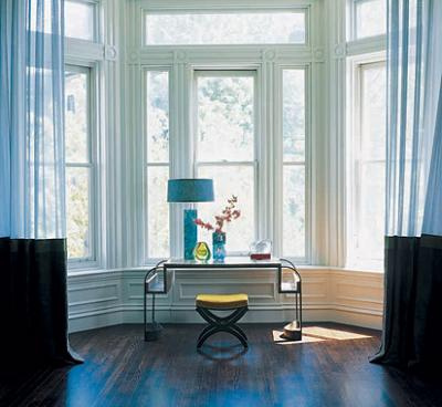 A bay window is a natural fit for a console table.