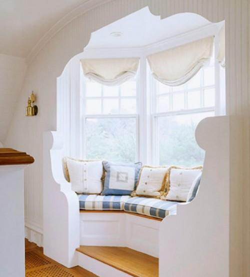 The right bay window can draw the eye to its nook cuz we all are attracted to cocoon-like spaces.