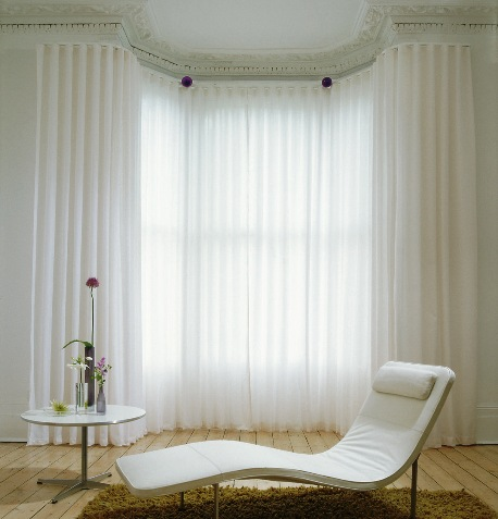 Bay window's negative space can become a comfortable place to lounge.