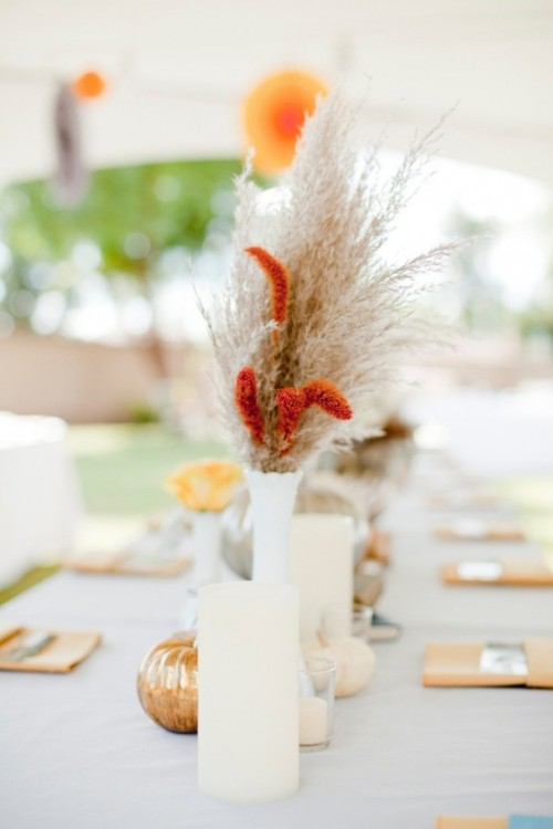 candles, dried grasses and blooms and faux pumpkins will make your fall table decor very chic and trendy