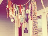 a boho gratitude garland for Thanksgiving with signs and tags can be hung over your porch or front door