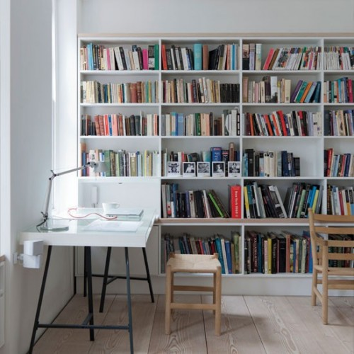 If you have a spacious dedicated home office you might want to make part of it a home library.