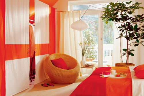 Bright orange attic bedroom design inspiration shelterness for Bright orange bedroom ideas