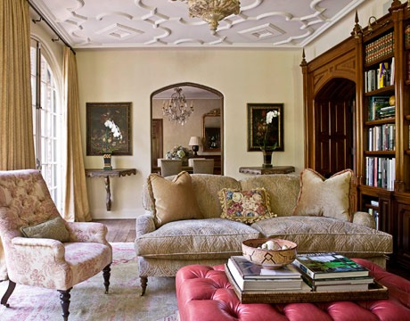 catchy ceiling molding is highlighted with traditional furniture and vintage artworks and bookcases