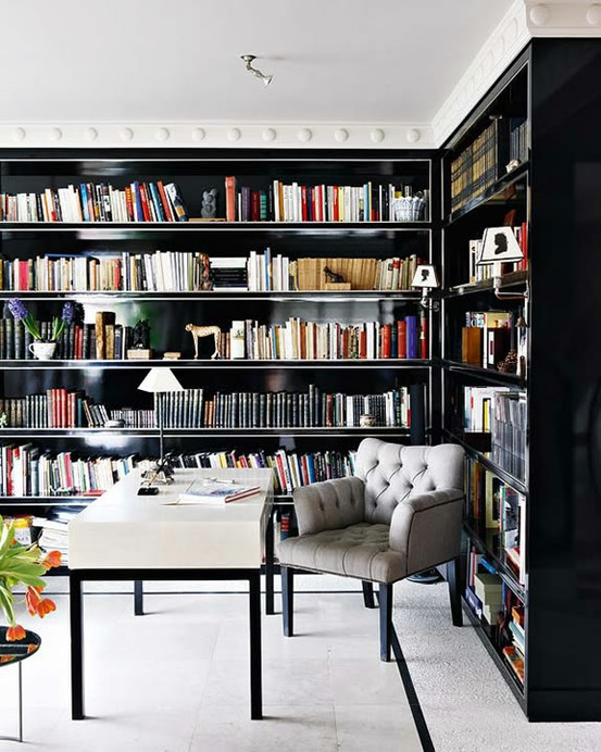 casual ceiling trim adds to the home office and contrasts the dark bookshelves