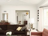 geometric molding on the ceiling and a round trim to highlight the chandelier and adds chic to the space