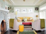molding on the ceiling adds to the space and white paneling echoes with it creatign a cohesive space