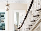 vintage and elegant trim on the ceiling plus a medallion add a vintage feel to the space
