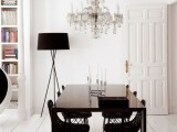 molding on the ceiling and an oversized crystal chandelier make the dining space wow