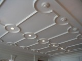 eye-catchy vintage molding on the ceiling plus lights make the space unique and give it a character