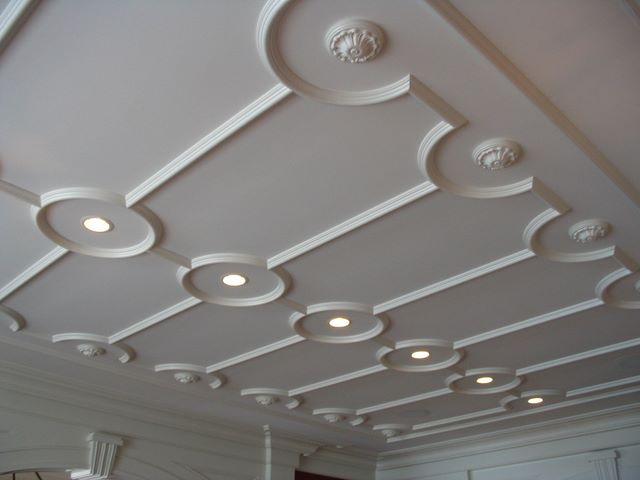 eye catchy vintage molding on the ceiling plus lights make the space unique and give it a character