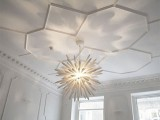 gorgeous hexagon molding brings trendy geometry to your space, while its white shade is non-obtrusive