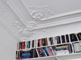 ceiling molding and bookshelves that come up to the ceiling and highlight it